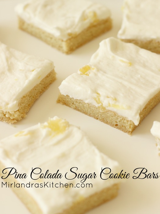 These Pina Colada Sugar Cookie Bars are the perfect pineapple and coconut dessert. Chewy coconut scented sugar cookies are topped with a fruity buttercream