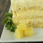 Thick layers of pound cake or angel food cake are filled with rich pineapple cream for this easy pineapple cake. Only five ingredients and ten minutes!