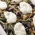 This updated version of gluten free green bean casserole is full of mushrooms, caramelized onions, and creamy cheese. Classic flavors reimagined make for a fun new holiday treat.